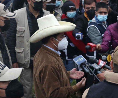 Socialist farmer Pedro Castillo ahead in Peru's contested presidential election