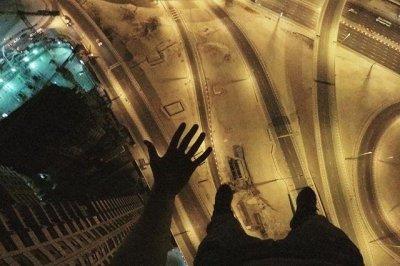 Daredevil climber hangs from crane high over Dubai