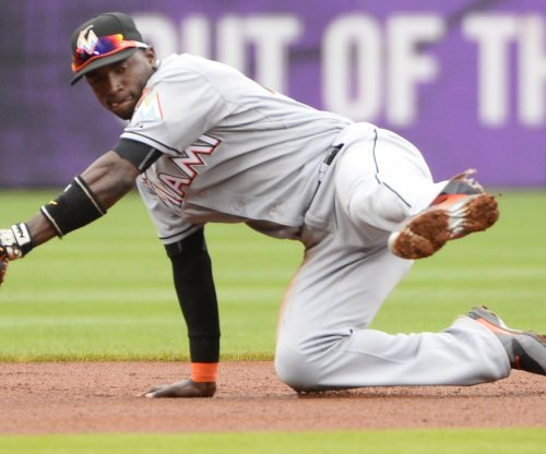 J.T. Realmuto powers Miami Marlins with six RBIs