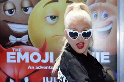 Christina Aguilera says her new album is 'coming'