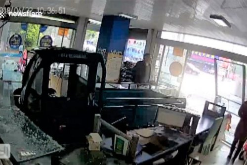 Dog crashes three-wheeler cab through wall of phone shop