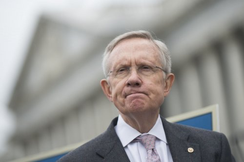 Obama postpones meeting while Reid, McConnell talk on debt ceiling