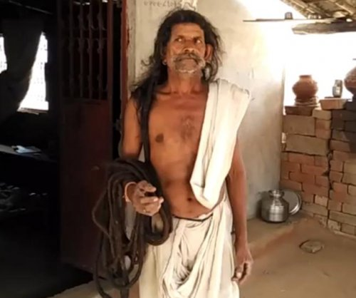Indian man seeks Guinness record with 62-foot-long hair