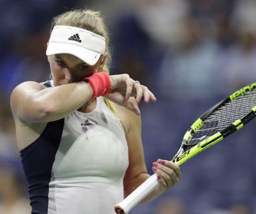 Caroline Wozniacki wins opening match in China