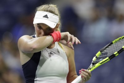 Caroline Wozniacki wins opening match in China