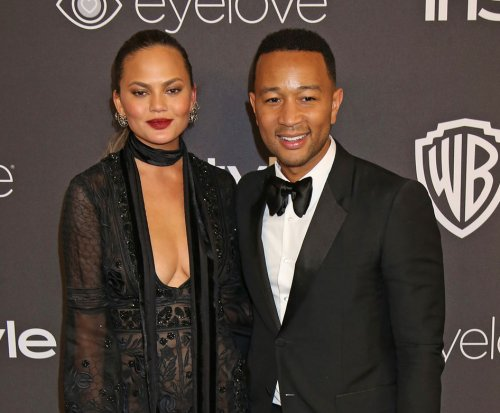 Chrissy Teigen says she had racist encounter with paparazzo