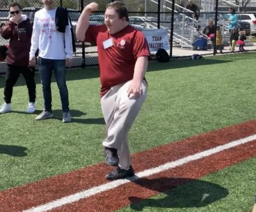 Boy with down syndrome gains fame with viral home run dance video