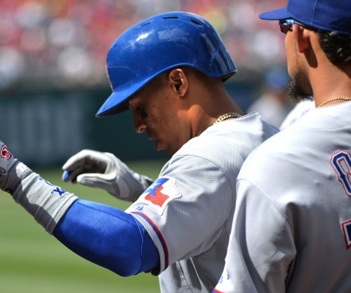 Choo's cycle backs up Harrison, Texas Rangers rout Colorado Rockies