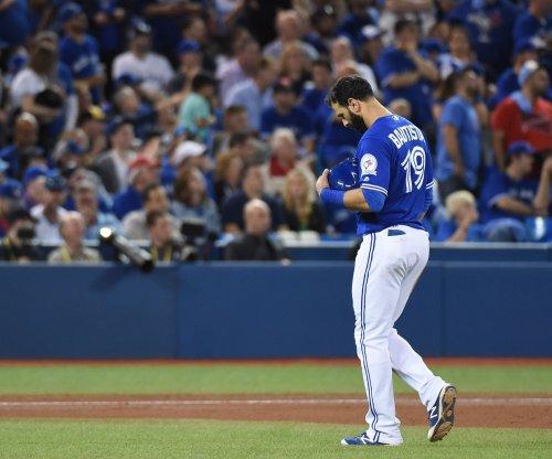 Toronto Blue Jays' Jose Bautista stealthily steals second base after walk