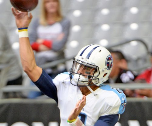 AFC wild-card game: Marcus Mariota's odd TD completion leads Tennessee Titans comeback
