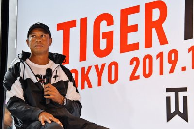 Tiger Woods sinks double birdies to take lead at Zozo Championship