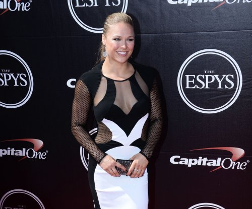 UFC fighters Ronda Rousey, Travis Browne officially dating