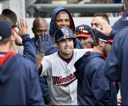 Minnesota Twins rally to edge Chicago White Sox in strange fashion