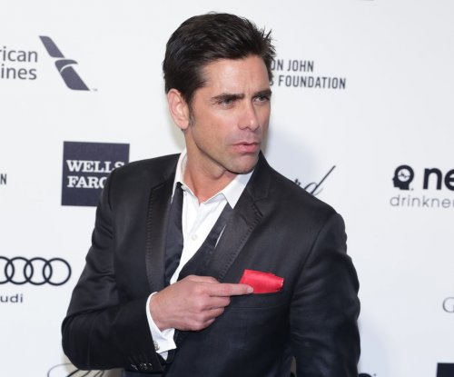 John Stamos bares backside for Paper amid 'Fuller House' hype