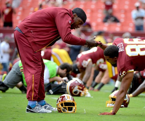 Robert Griffin III passes exit Washington Redskins physical, one step closer to release