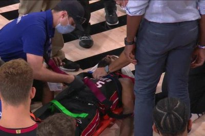 Heat's Derrick Jones Jr. 'moving better' after being stretchered off court
