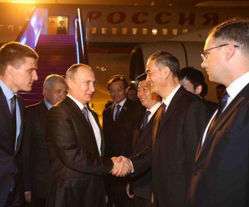 What accounts for Russian President Vladimir Putin's popularity?
