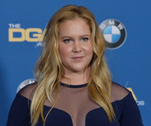 Amy Schumer on marrying Chris Fischer 'quickly': 'We're so in love'
