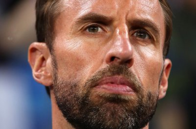 World Cup: England's manager dislocates shoulder during jog