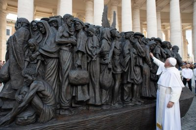 Pope Francis unveils statue at Vatican honoring migrants, refugees