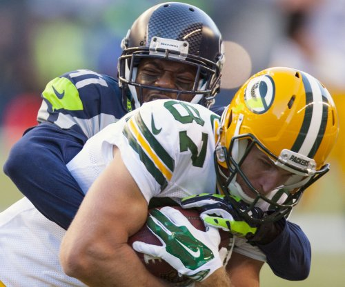 Green Bay Packers try to solve Seattle Seahawks, '12th man' in NFC Championship Game