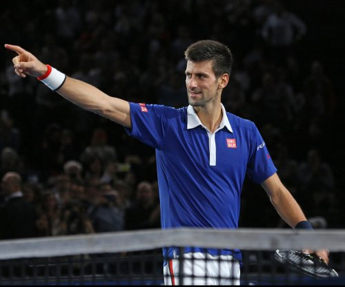 Novak Djokovic cruises in ATP Finals opener