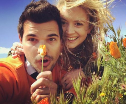 Billie Lourd, Taylor Lautner cozy up in poppy field