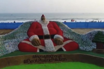 Santa sculpture crafted from sand, 10,000 plastic bottles