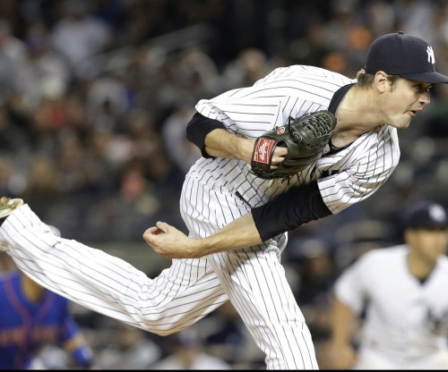 New York Yankees LHP Andrew Miller cleared to pitch with broken bone in wrist