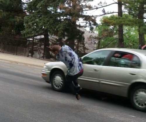 Skateboarder narrowly escapes being hit by car