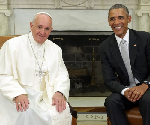 President Obama gifts Pope Francis sculpture, historic key