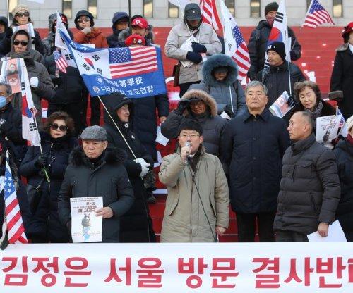 South Koreans protest Kim Jong Un's visit