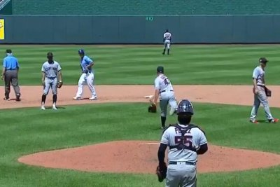 Cleveland Indians' Trevor Bauer throws ball over center-field fence in anger