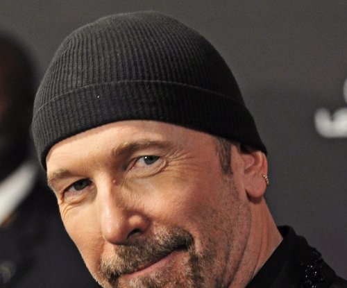 U2's The Edge falls off stage at concert