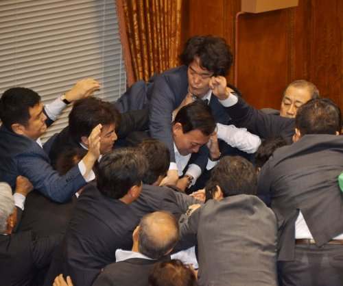 Japan ratifies controversial bills that allow military to fight overseas