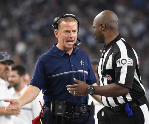 Dallas Cowboys coach Jason Garrett defends wasting a down in loss to Green Bay Packers