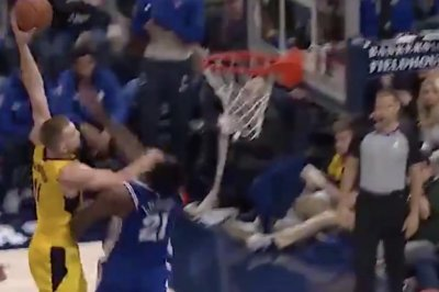 Domantas Sabonis dunks all over Joel Embiid