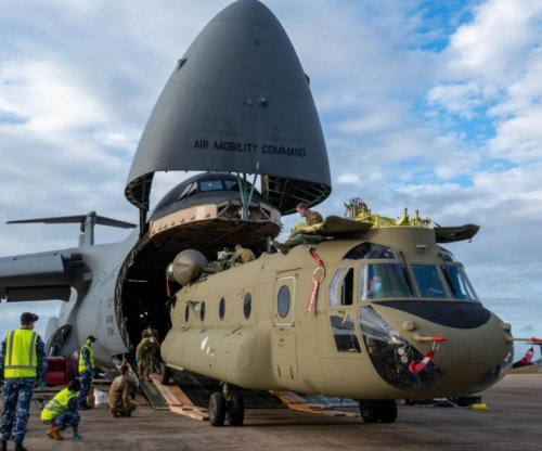 C-5 Galaxy cargo plane carries Chinook helicopters from U.S. to Australia