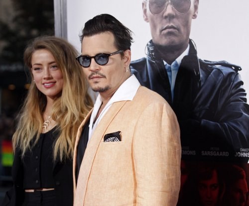 Johnny Depp, wife Amber Heard attend 'Black Mass' screening