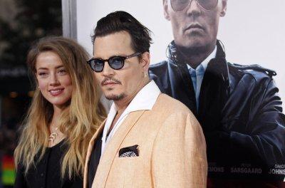 Johnny Depp, wife Amber Heard attend 'Black Mass' screening