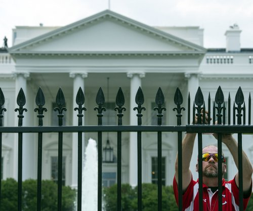 Person who jumped White House barrier in custody
