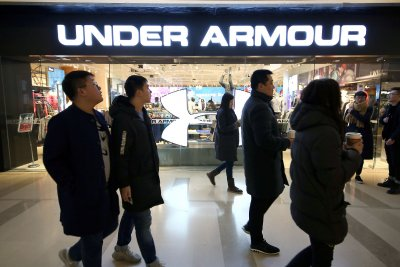 Under Armour to cut workforce by 3%; Nike shares way up