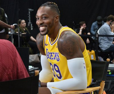 Lakers' Dwight Howard swats Coby White's shot into cameraman