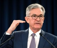 U.S. markets fall flat as Fed Chairman Jerome Powell warns of 'elevated' assets