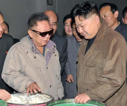 Kim Jong Un was never photographed with revered grandfather, experts say