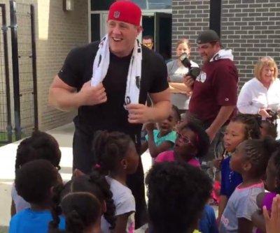 J.J. Watt shows off dance moves for kids at YMCA