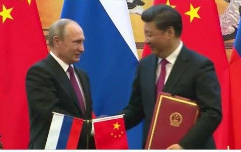 China, Russia pledge business partnership worth $50 billion