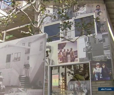 Artist covers family home of 70 years in portraits prior to demolition