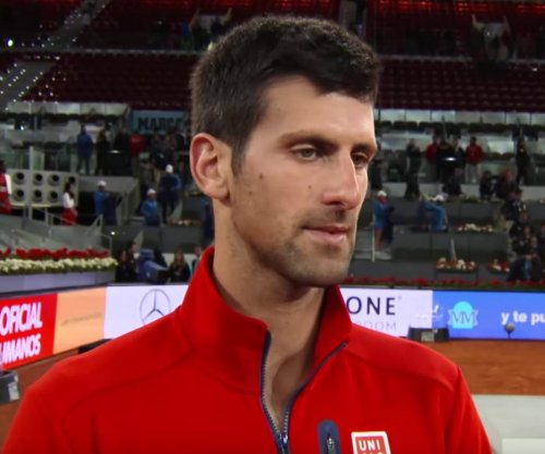 Novak Djokovic fights off Andy Murray to win Madrid Open