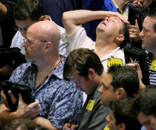 Oil prices sink as volatility takes hold